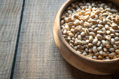 Roasted soybeans in wooden bowl Stock Images