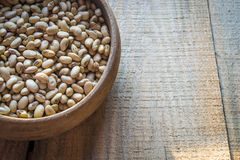 Roasted soybeans in wooden bowl Stock Photo