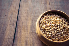 Roasted soybeans in wooden bowl Royalty Free Stock Photo