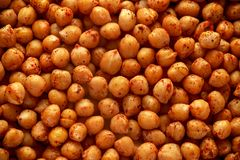 Roasted spicy chickpeas, background, texture. Healthy food. royalty free stock photos