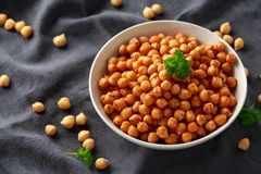 Roasted spicy chickpeas in white bowl. Healthy food royalty free stock photo