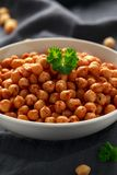 Roasted spicy chickpeas in white bowl. Healthy food.  stock image