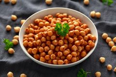 Roasted spicy chickpeas in white bowl. Healthy food.  royalty free stock images