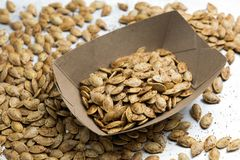 Roasted spicy pumpkin seeds with cumin and brown sugar stock photography