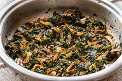 Roasted Spinach in pan. stock photography