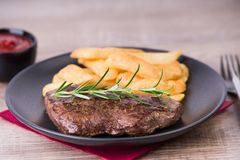 Roasted steak with french fries and onions stock image
