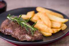 Roasted steak with french fries and onions stock images