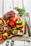 Roasted steak and vegetables with salt Royalty Free Stock Photo
