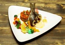 Roasted stuffed fish Stock Images
