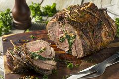 Roasted Stuffed Leg of Lamb. With Spinach and Pine Nuts stock photos