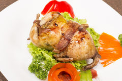 Roasted stuffed quail Stock Photos