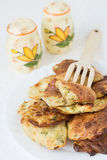 Roasted Summer Squash Rissoles. A Wooden Fork and Salt and Pepper Shakers Stock Photography