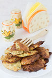 Roasted Summer Squash Rissoles. A Wooden Fork, Salt and Pepper Shakers and a Napkin Holder Royalty Free Stock Photography