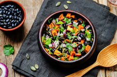 Roasted sweet potato black bean pepita avocado salad. Toning. selective focus Stock Image