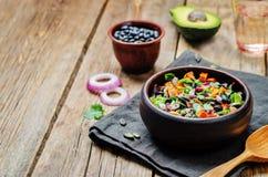 Roasted sweet potato black bean pepita avocado salad. Toning. selective focus stock images