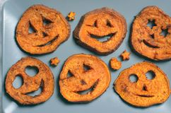 Roasted Sweet Potato Carving Funny Faces, Halloween Symbol, Creative Food. Roasted Sweet Potato Carving Funny Faces, Halloween Symbol Creative Food for Kids royalty free stock photos