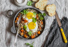 Roasted sweet potato, quinoa and fried egg bowl. Delicious healthy breakfast or lunch. Royalty Free Stock Photo