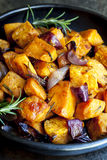 Roasted Sweet Potato with Red Onion and Rosemary stock images