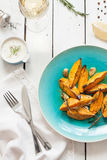 Roasted sweet potatoes on blue plate from above Stock Photography