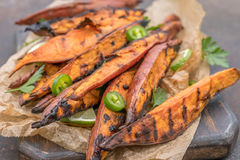 Roasted sweet potatoes on the grill Royalty Free Stock Photo