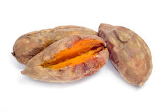 Roasted sweet potatoes. Some roasted sweet potatoes on a white background stock image