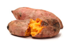 Roasted sweet potatoes. On a white background Royalty Free Stock Images