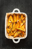 Roasted sweet potatoes in white ceramic dish from above Stock Photos