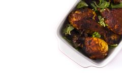 Roasted tandoori chicken with basmati rice isolated. On white background. Top view. Copyspace stock image