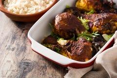 Roasted tandoori chicken with basmati rice on wood. En table stock photos