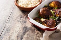 Roasted tandoori chicken with basmati rice on wood. En table. Copyspace stock images