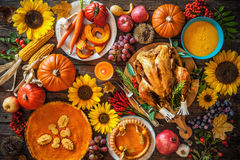 Roasted Thanksgiving Turkey. Thanksgiving dinner. Roasted turkey with pumpkins and sunflowers on wooden table stock image