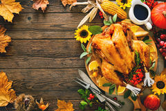 Roasted Thanksgiving Turkey. Thanksgiving dinner. Roasted turkey with pumpkins and sunflowers on wooden table stock photo
