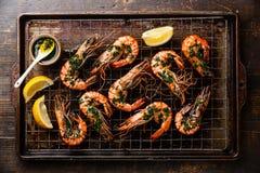 Roasted tiger prawns on baking sheet background Royalty Free Stock Images