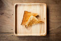 Roasted toast bread on wooden plate. Delicious breakfast. Royalty Free Stock Images