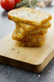 Roasted toasts with sea salt and thyme. On a kitchen board Royalty Free Stock Photos