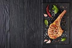Roasted tomahawk steak on a board
