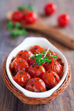 Roasted tomatoes. With thyme and balsamic vinegar, selective focus Stock Photo