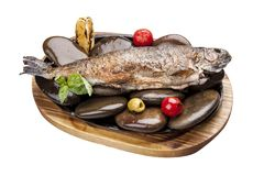 Roasted trout on the Board with stones stock image