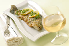 Roasted trout with lemon and dill Royalty Free Stock Images