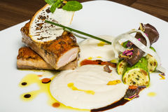 Roasted tuna with zucchini and white sauce Royalty Free Stock Photography