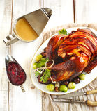 Roasted turkey with bacon and garnished with chestnuts and brussels sprouts. Stock Photos