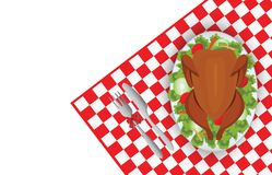 Roasted turkey bird on oval plate with fork and knife on red tab Royalty Free Stock Image
