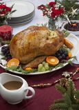 Roasted Turkey for Christmas Dinner. Roasted herb rubbed turkey garnished with fresh grapes, oranges, and cranberry is ready for Christmas dinner. Ornaments royalty free stock photography