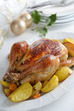 Roasted turkey on a Christmas table Stock Photos