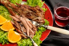 Roasted turkey drumstick with orange, lettuce and rose wine on b. Lack satin cloth closeup macro horizontal Stock Photography