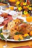 Roasted turkey feast. Garnished citrus glazed roasted turkey on holiday table, pumpkins, flowers, and white wine stock photos