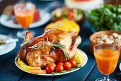 Roasted turkey on festive table Stock Photo