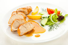 Roasted turkey fillet. Roasted chicken fillet and vegetables royalty free stock photos