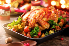 Roasted turkey garnished with potato. Thanksgiving or Christmas dinner. Roasted turkey garnished with potato, vegetables and cranberries. Thanksgiving or