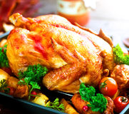 Roasted turkey garnished with potato. Thanksgiving or Christmas dinner. Roasted turkey garnished with potato, vegetables and cranberries. Thanksgiving or royalty free stock photo